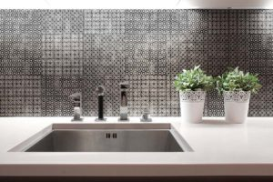 Aluminum sink in kitchen with flowers on wheat